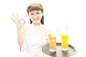 Happy waitress making ok sign