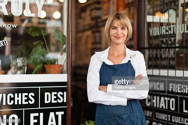 Smiling waitress standing in cafe
