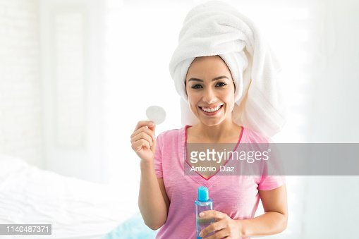 Smiling With Skincare Product : Stock Photo