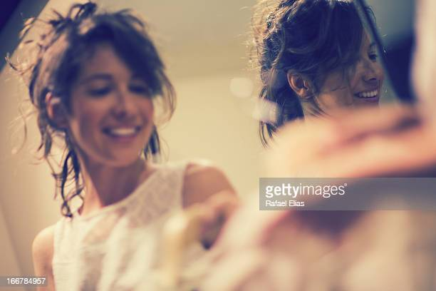 Smiling woman and her reflection in mirror