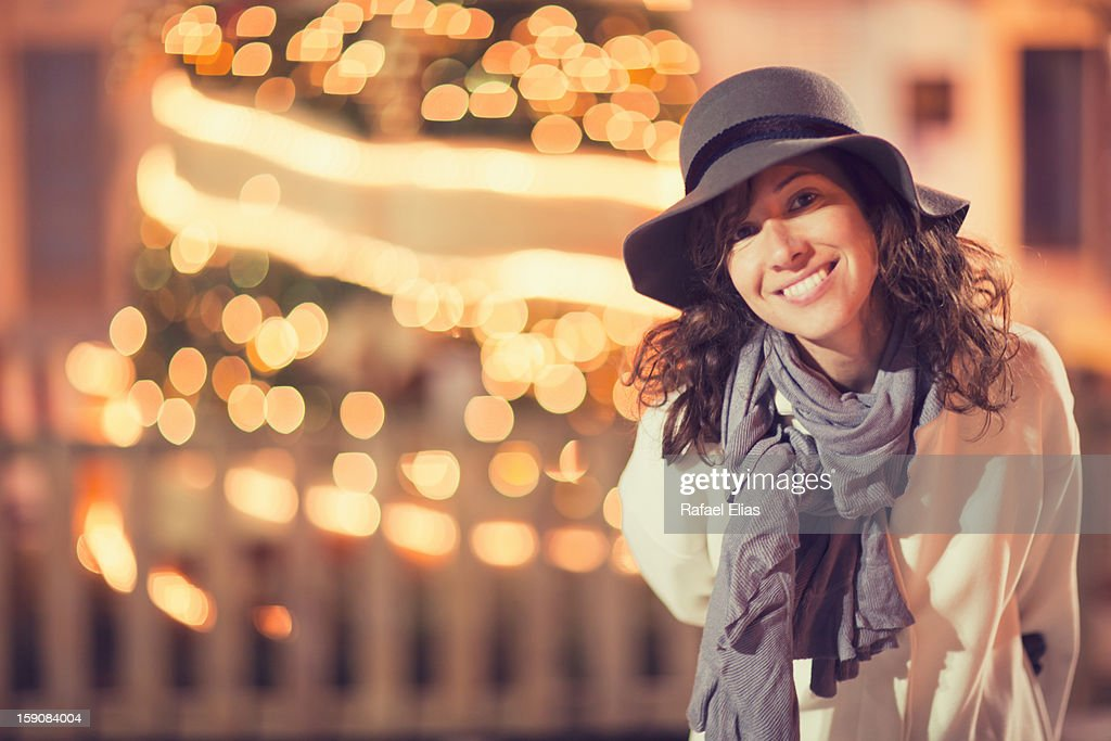 Smiling woman and lights : Stock Photo