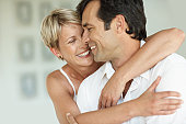 Smiling woman and man in loving embrace