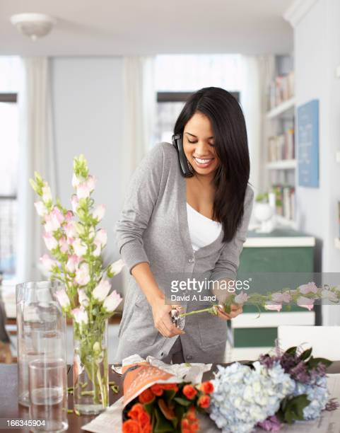 Smiling woman arranging flowers