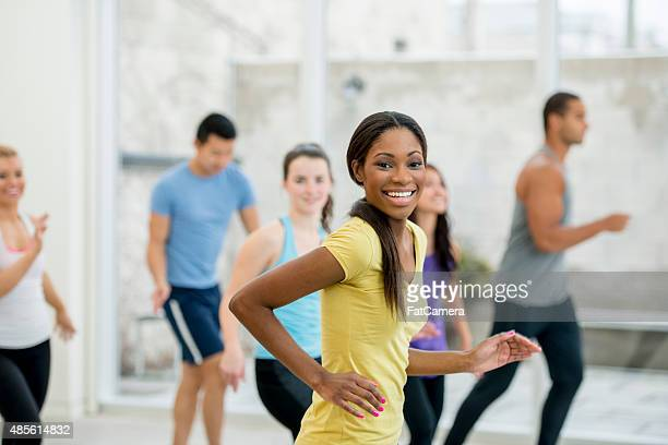 Smiling Woman at a Gym Class