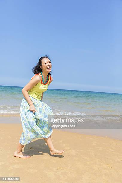 Smiling Woman At Beach