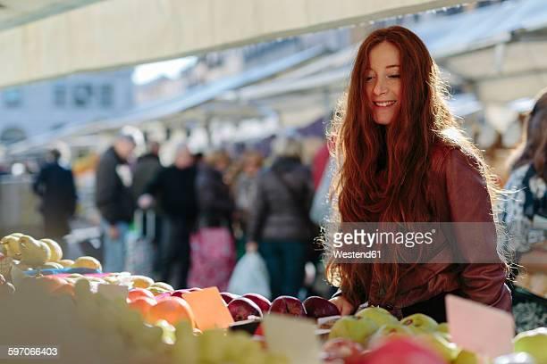 Smiling woman at fruit market