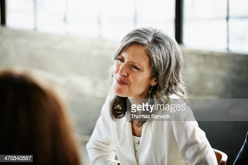Smiling woman at table with friends during party