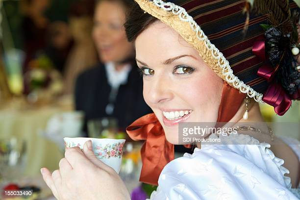 Smiling Woman at Victorian tea party