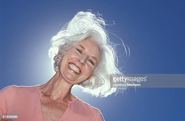 Smiling woman backlit