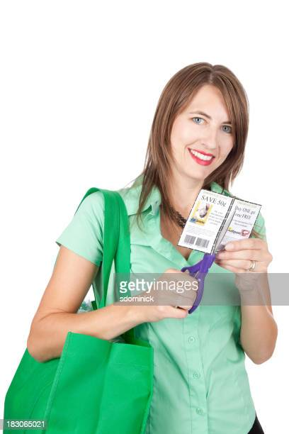 Smiling Woman Cutting Coupons