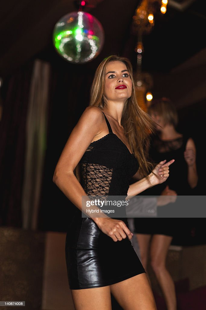 Smiling woman dancing in club : Stock Photo