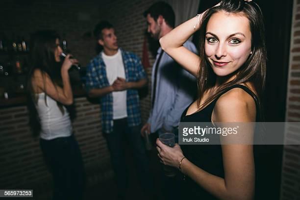 Smiling woman dancing in nightclub