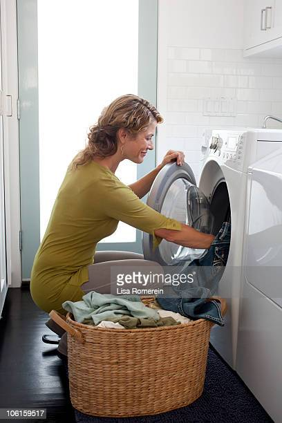 Smiling woman doing the laundry