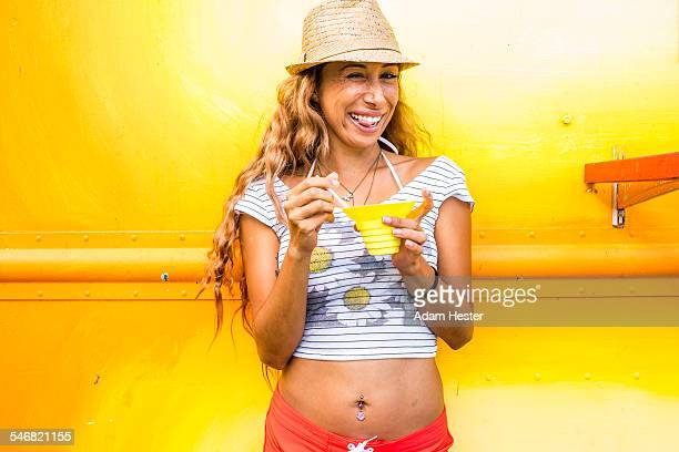 Smiling woman eating shaved ice