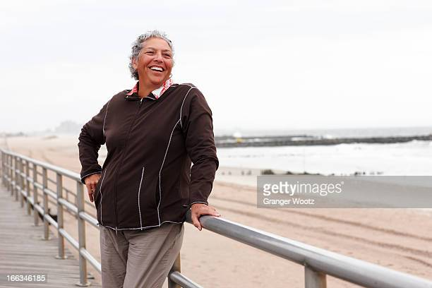 Smiling woman enjoying boardwalk