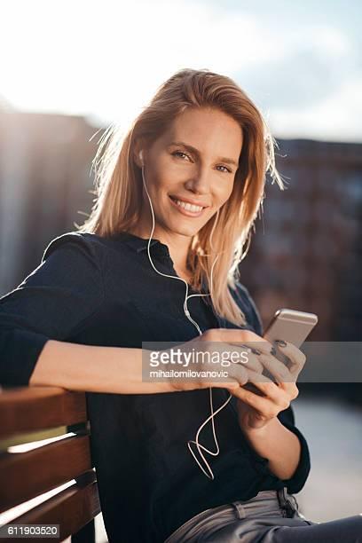 Smiling woman enjoying her favorite song