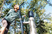 Smiling Woman Exercising  at Outdoor Gym