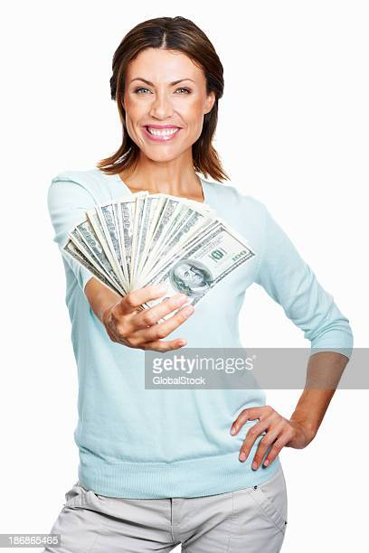 Smiling woman fanning a large amount of $100 bills