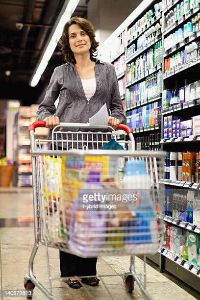 Smiling woman grocery shopping