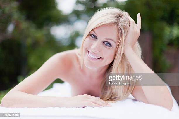 Smiling woman having massage outdoors