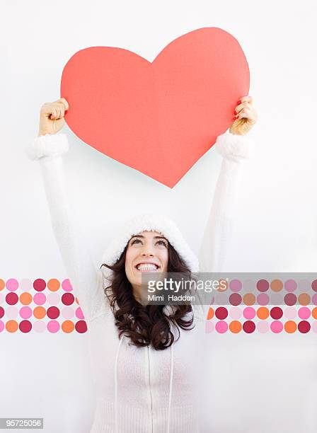 Smiling Woman Holding Giant Heart