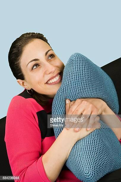 Smiling Woman Hugging a Cushion