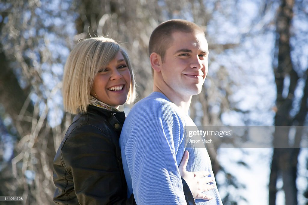 Smiling woman hugging her husband : Stock Photo