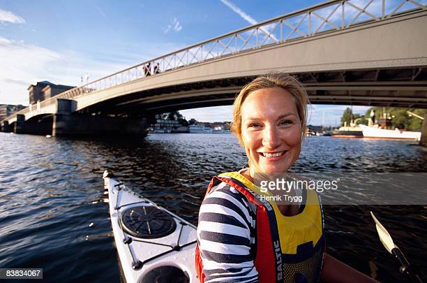 Smiling woman in a kayak Stockholm Sweden.