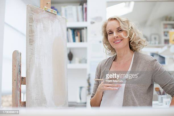 Smiling woman in art studio
