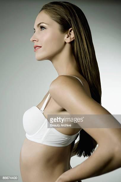 Smiling woman in bra