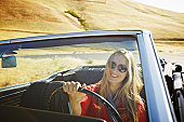Smiling woman in convertible