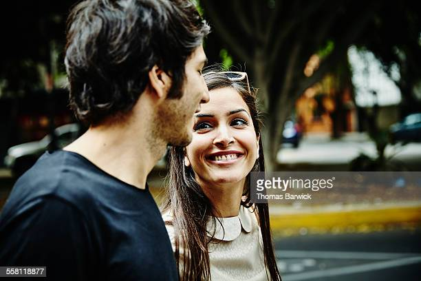 Smiling woman in discussion with boyfriend