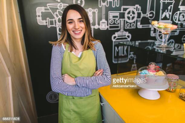 Smiling woman in her cake shop