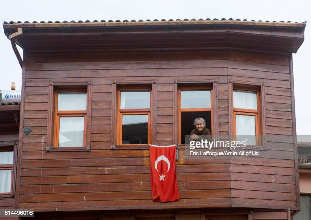 Smiling woman in her old wooden style house near the Bosphorus sea Marmara Region Istanbul Turkey on April 27 2014 in Istanbul Turkey