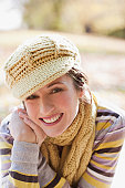 Smiling woman in knit cap and scarf