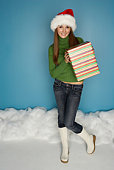Smiling woman in snow holding gift