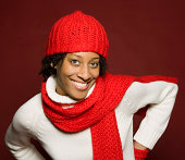 Smiling woman in stocking cap and scarf
