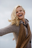 Smiling woman in sweater and scarf