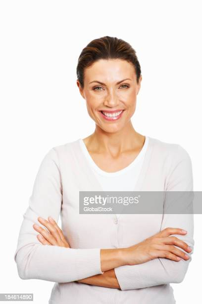 Smiling woman in white shirt with arms crossed