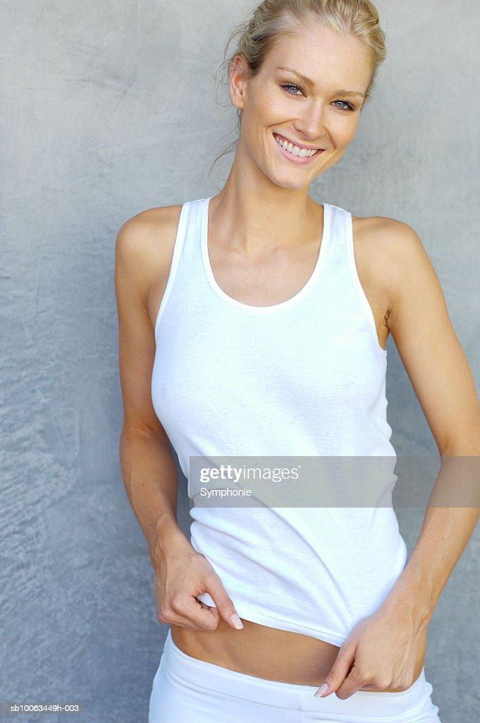 Smiling woman, looking at camera : Stock Photo
