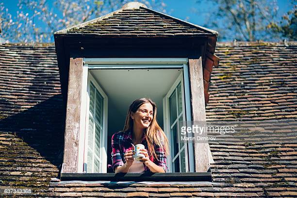 Smiling woman looking through the window