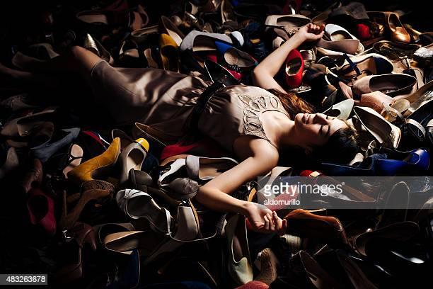 Smiling woman lying on high heels