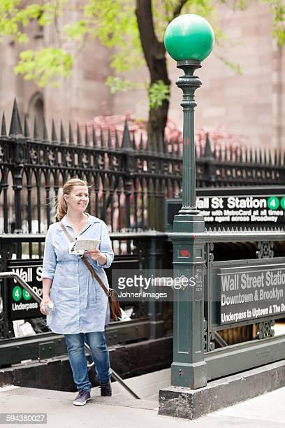 Smiling woman near subway station, New York City, USA