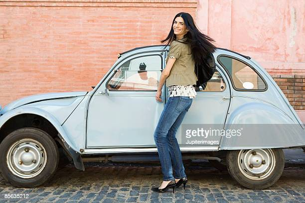 Smiling woman next to car