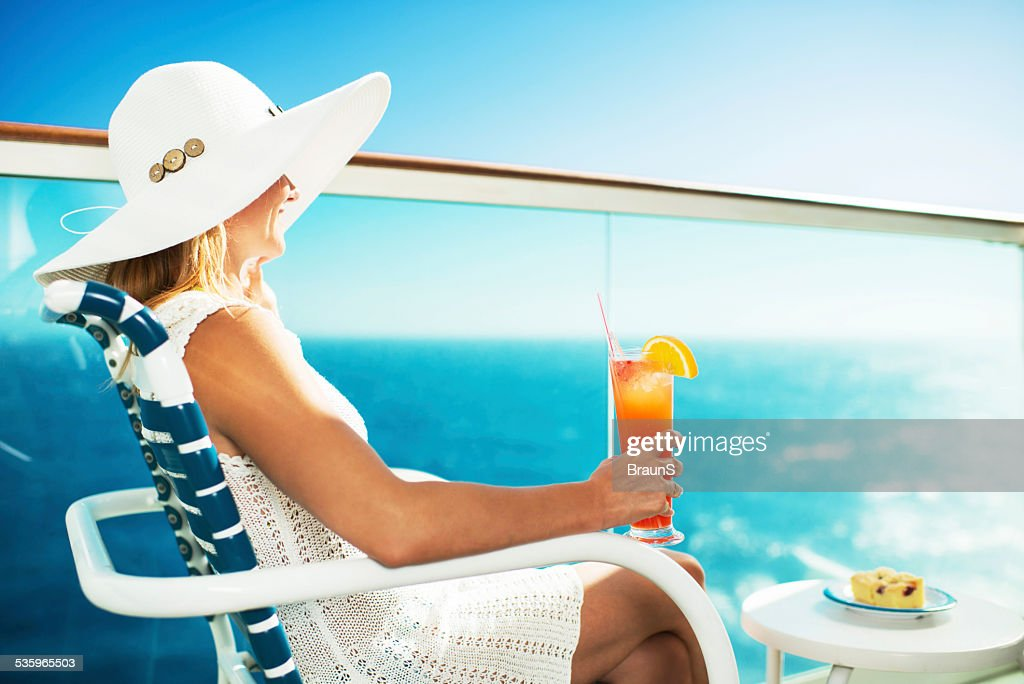 Smiling woman on a balcony. : Stock Photo