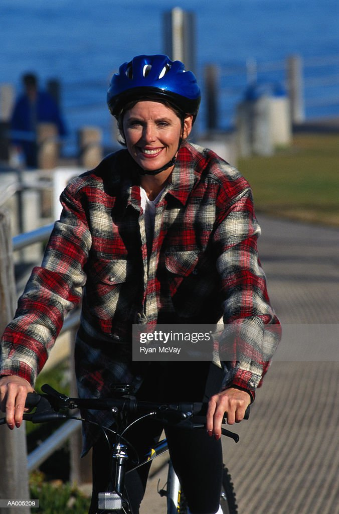 Smiling Woman on a Bicycle : Stock Photo