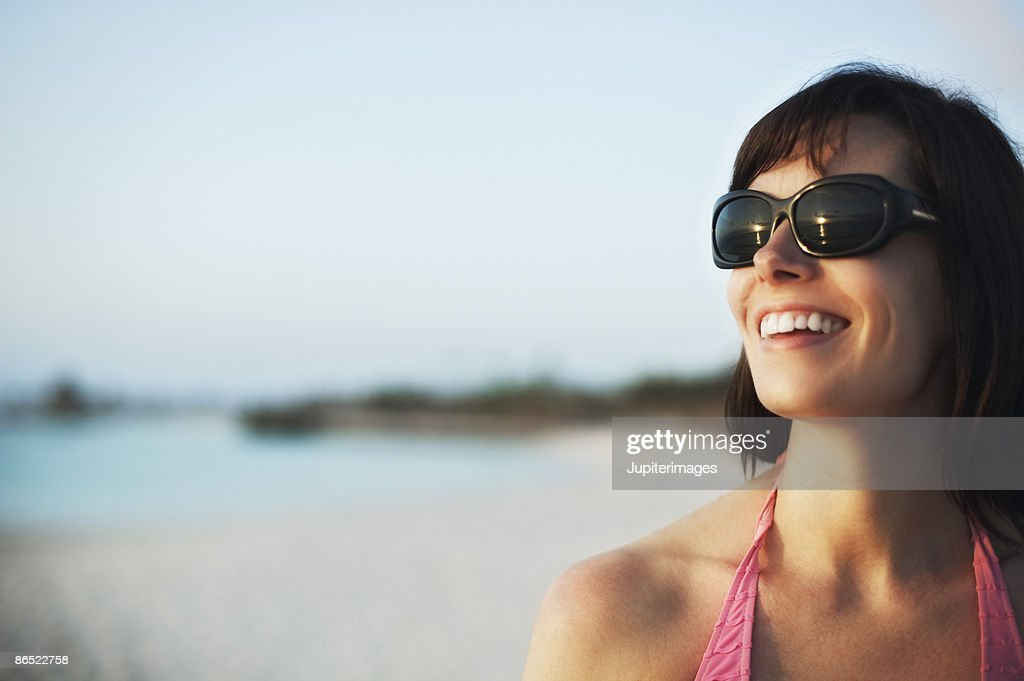 Smiling woman on beach : Stock Photo