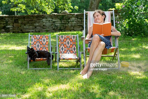 Smiling woman on sun chair
