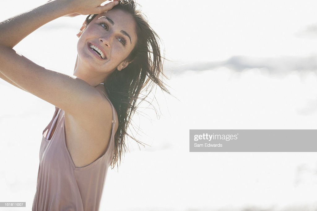 Smiling woman on sunny beach