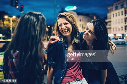 Smiling woman outdoors at night